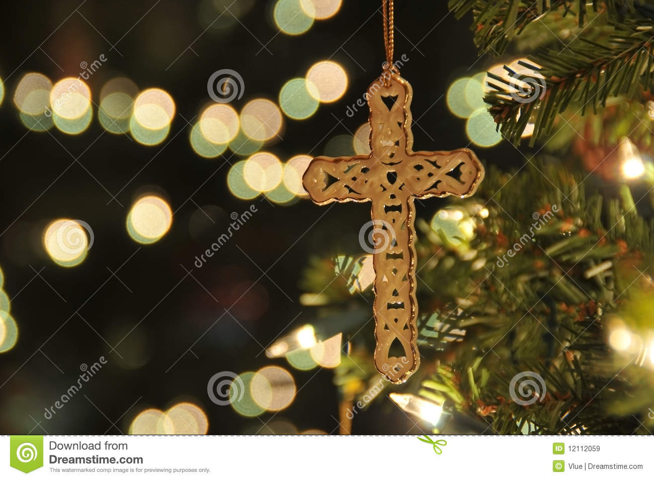 Cross ornament on Christmas tree with bokeh. Taken with a remote to ...