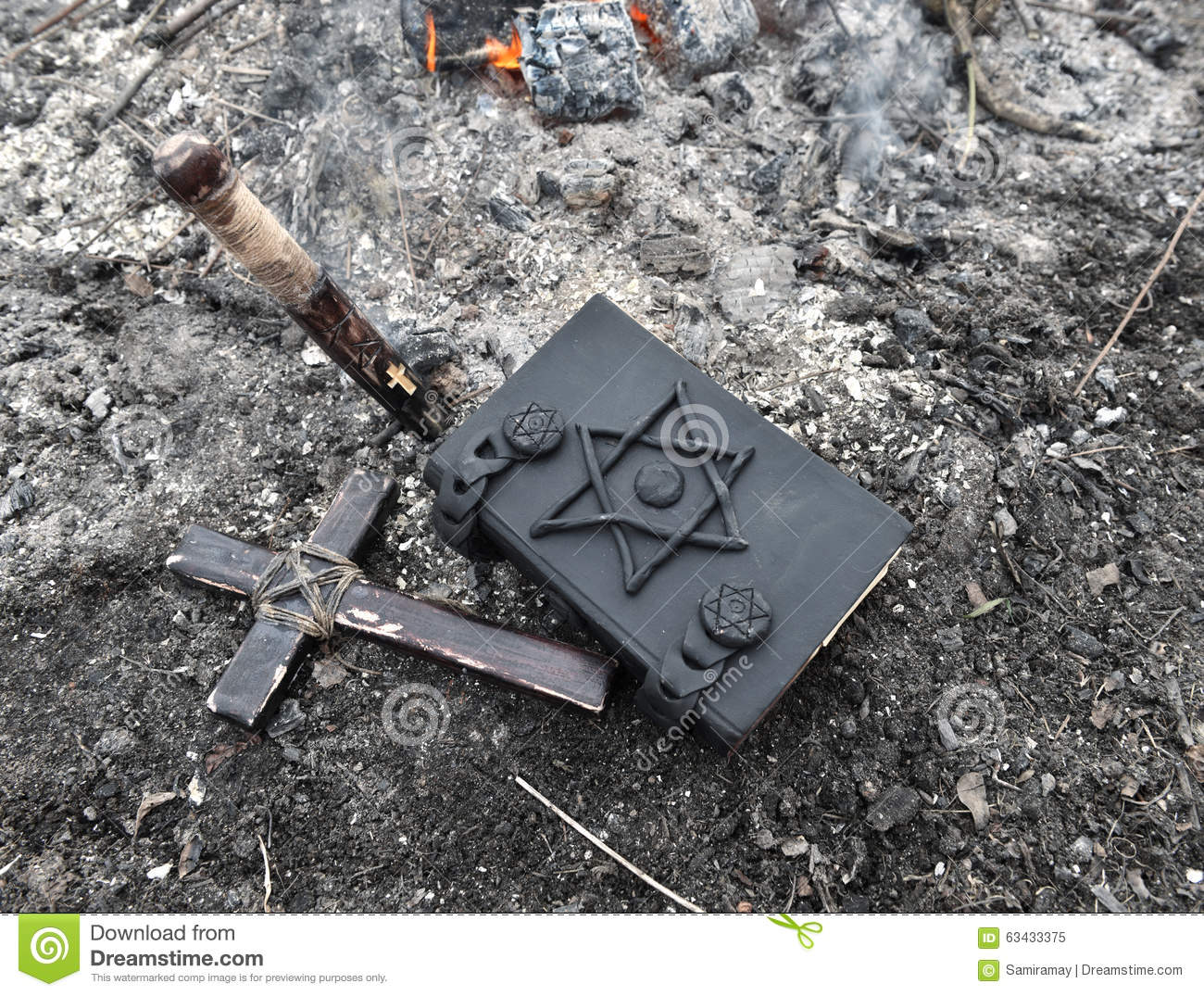 Cross, Stake And Magic Book On The Ashes Stock Image - Image