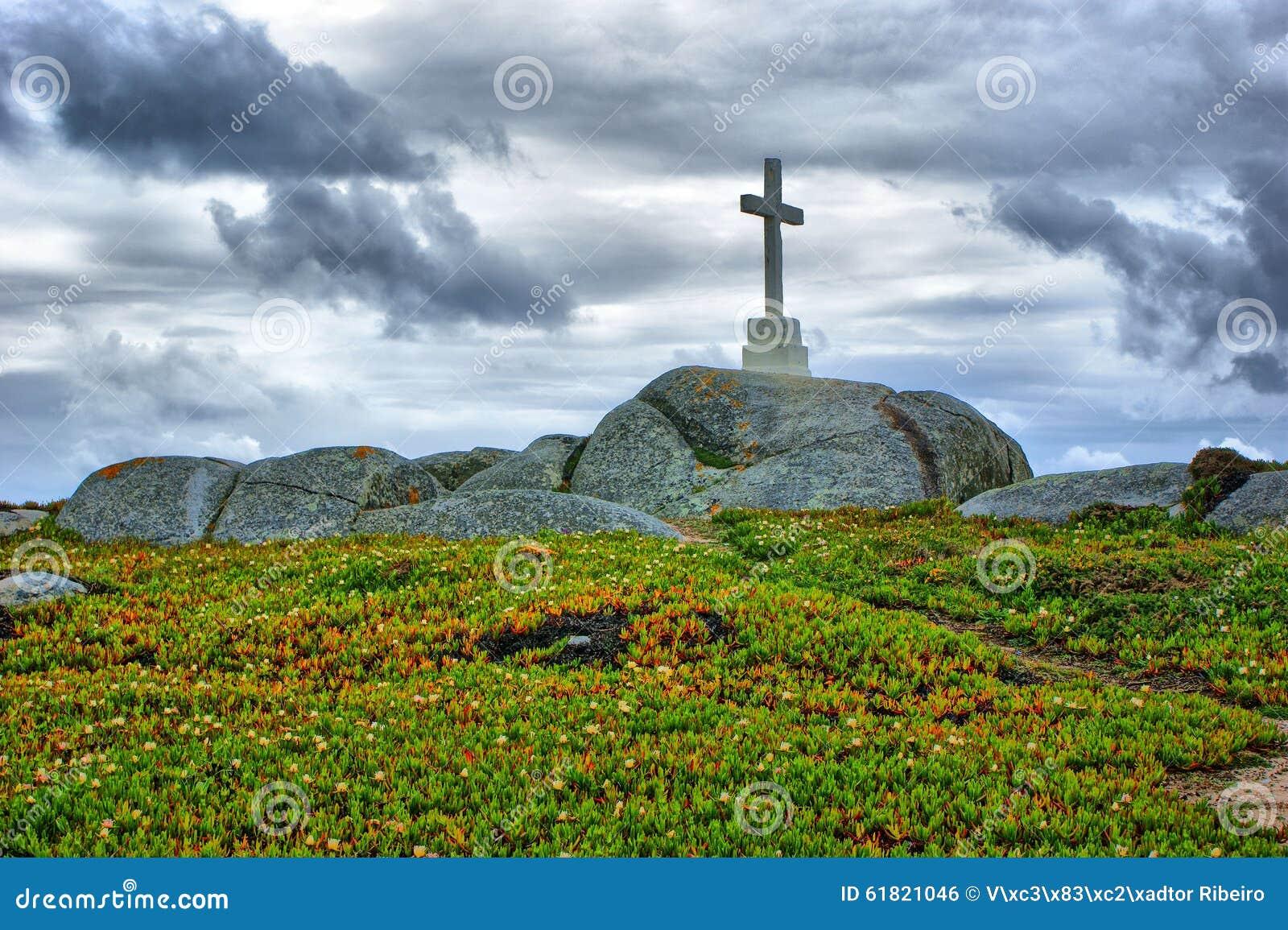 Cross on top of the granite rocks