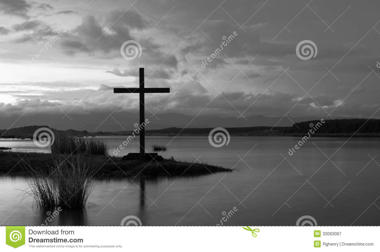 Silhouette of the holy cross on background of storm clouds stock - Cross