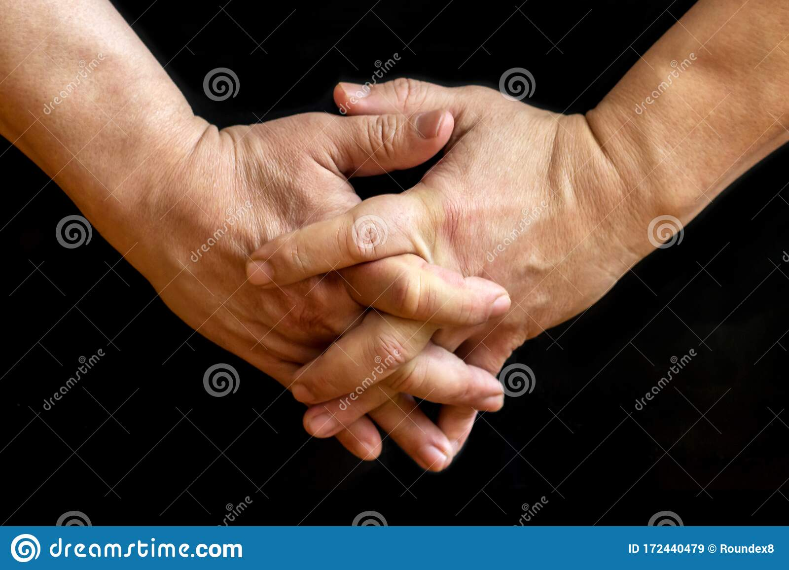 Hands With Fingers Interlocked Stock Photography