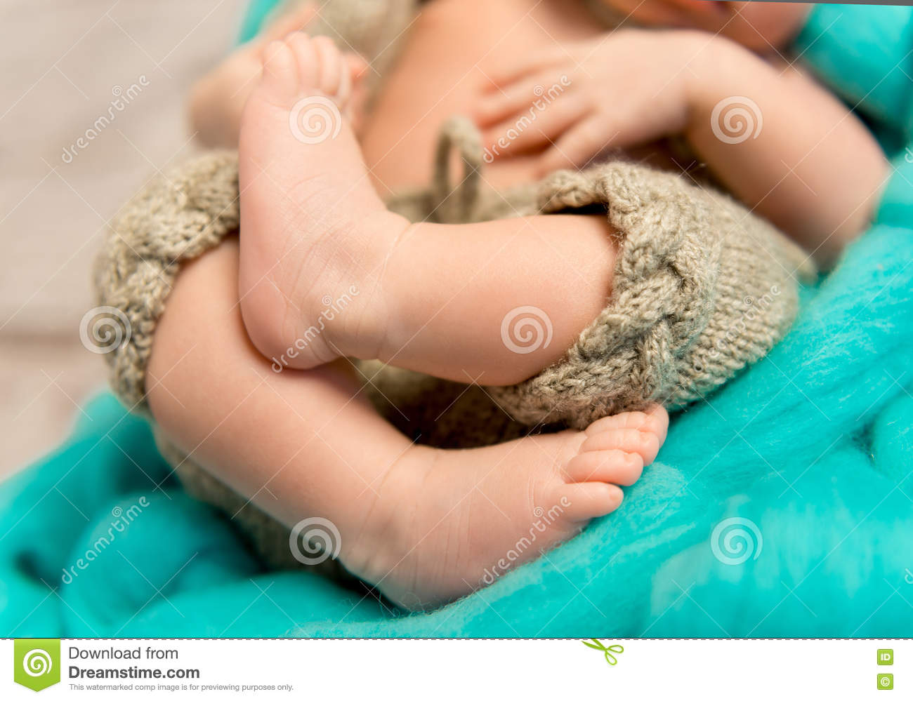 1852533a6 Crossed Legs Of A Newborn Baby Stock Photo - Image of pants