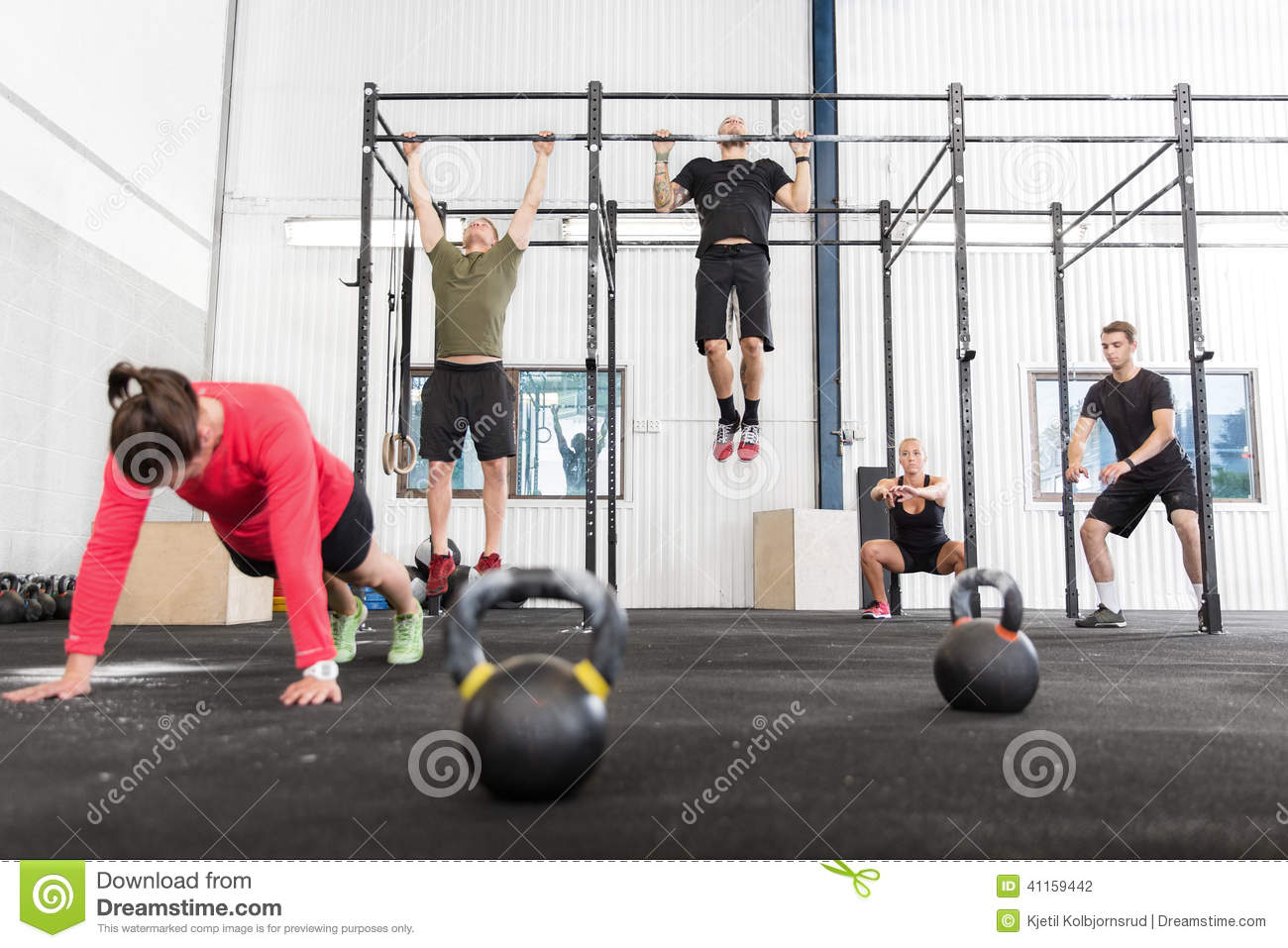 Crossfit group trains different exercises stock photo