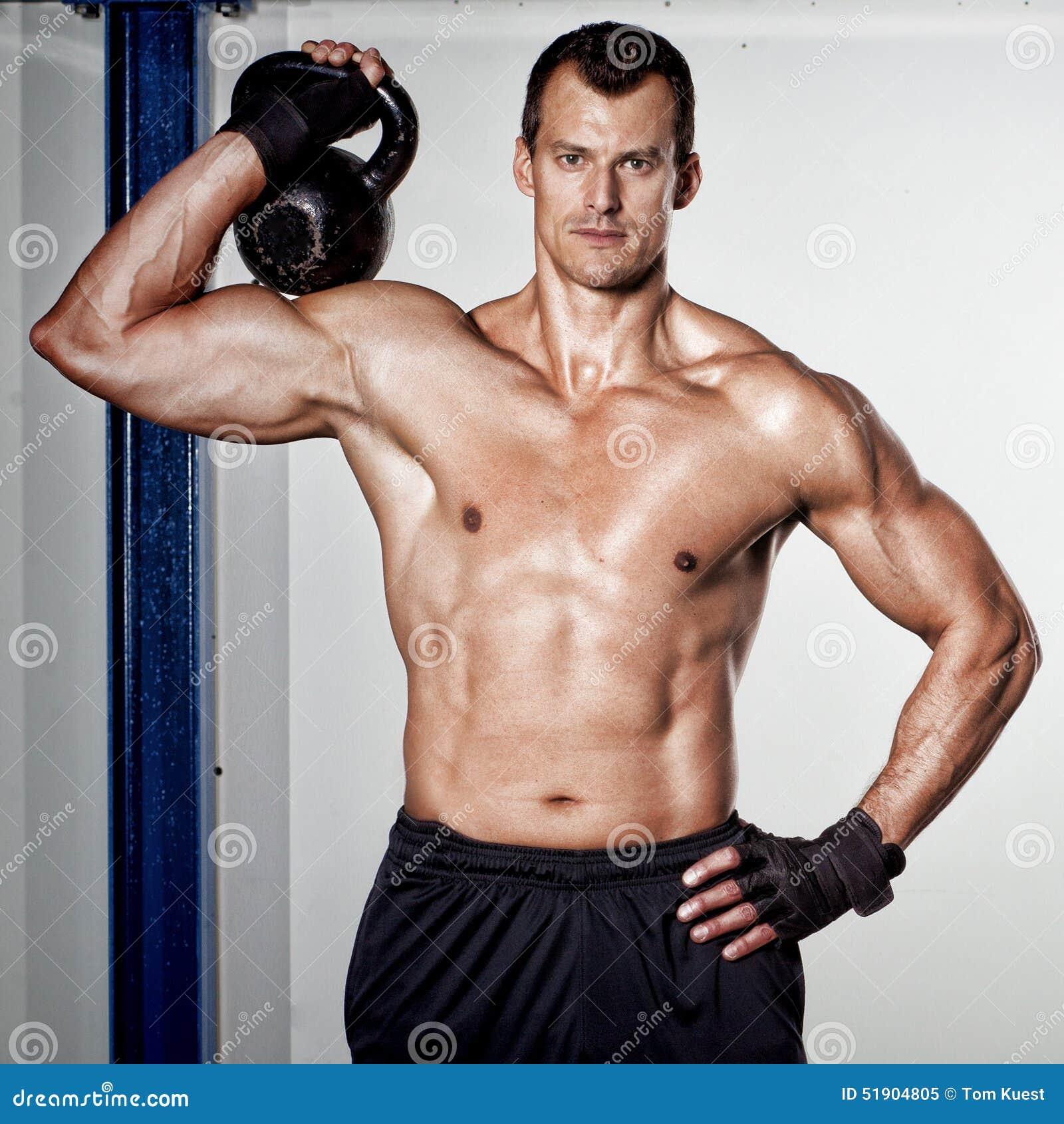 Kettlebell Workout For Men: Crossfit Kettlebell Fitness Training Man Stock Photo