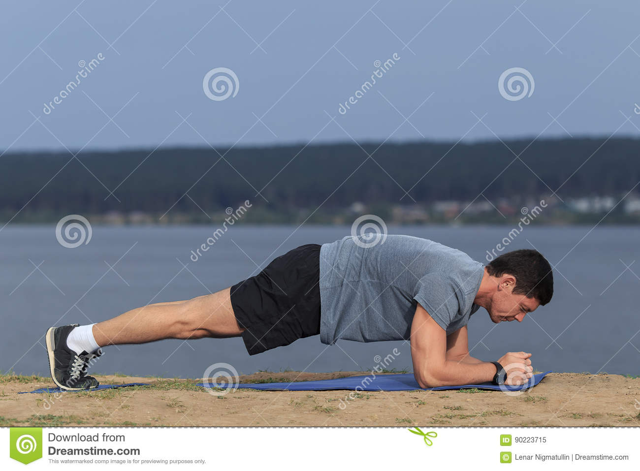 Crossfit training fitness man doing plank core exercise working out his midsection core muscles.