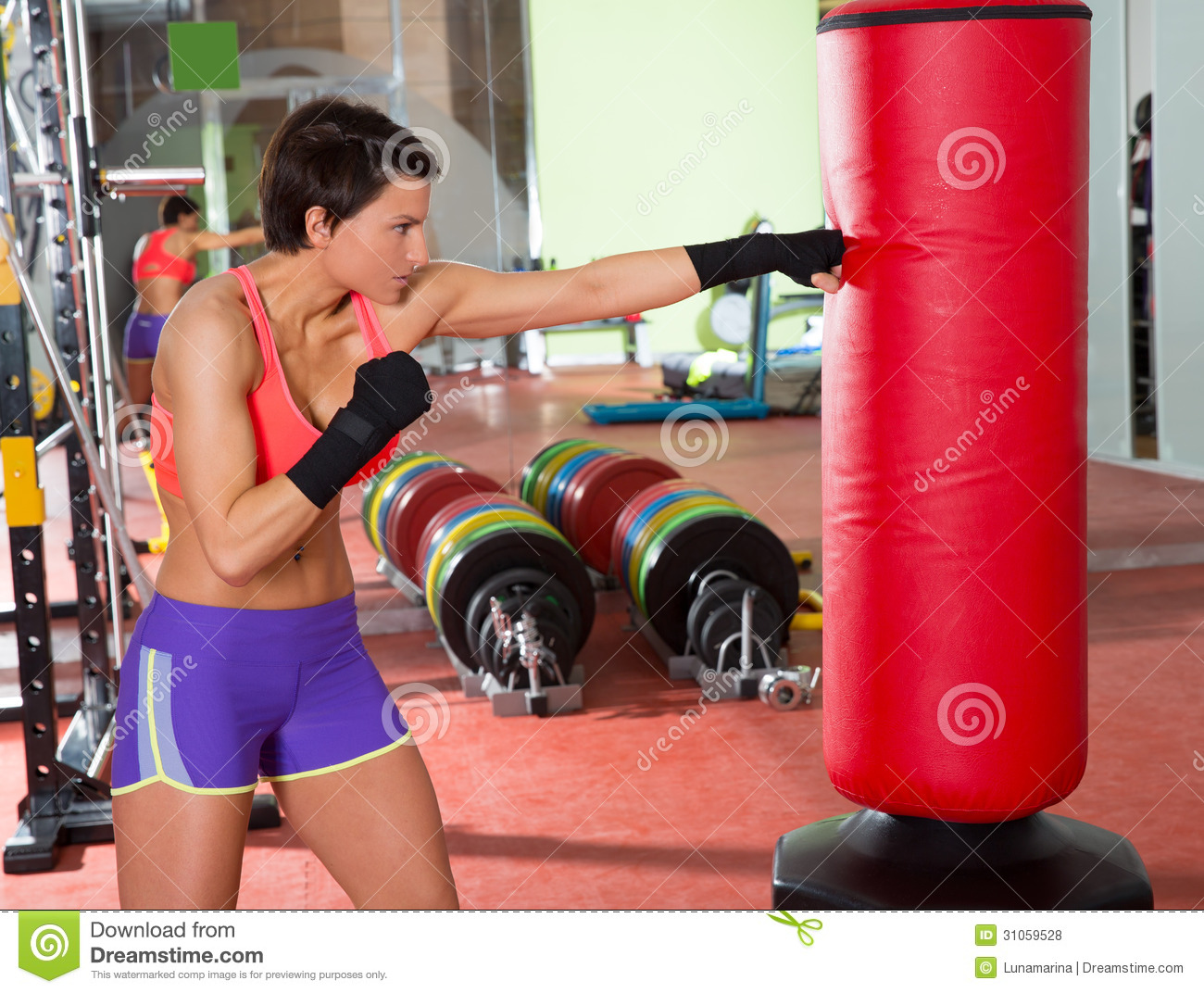 Crossfit Woman Boxing With Red Punching Bag Royalty Free