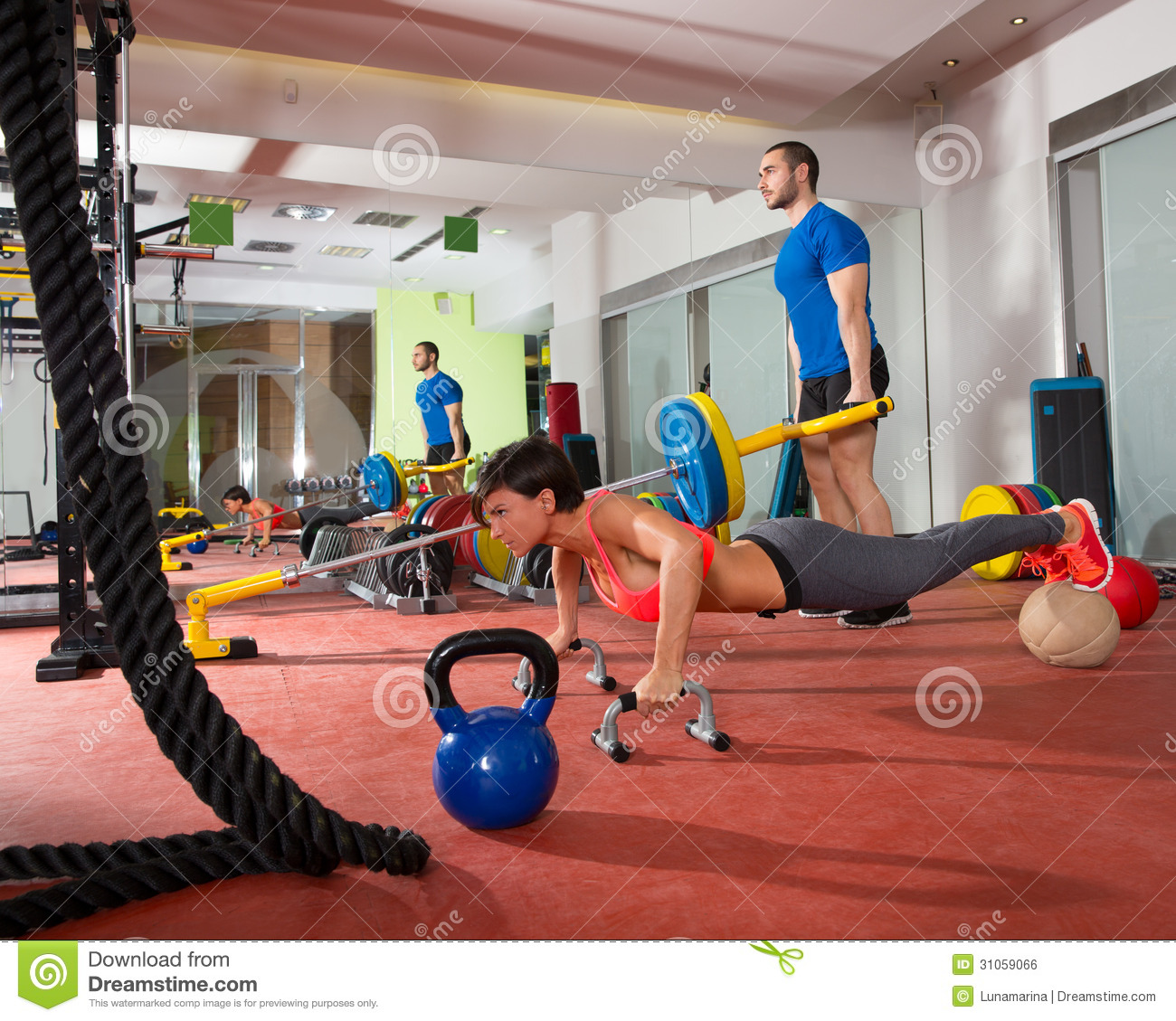 Women S Crossfit Workouts: Crossfit Woman Push Ups Exercise And Man Weight Lifting