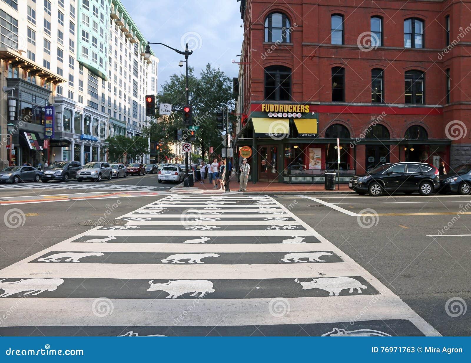 Crosswalk with zodiac symbols In Chinatown