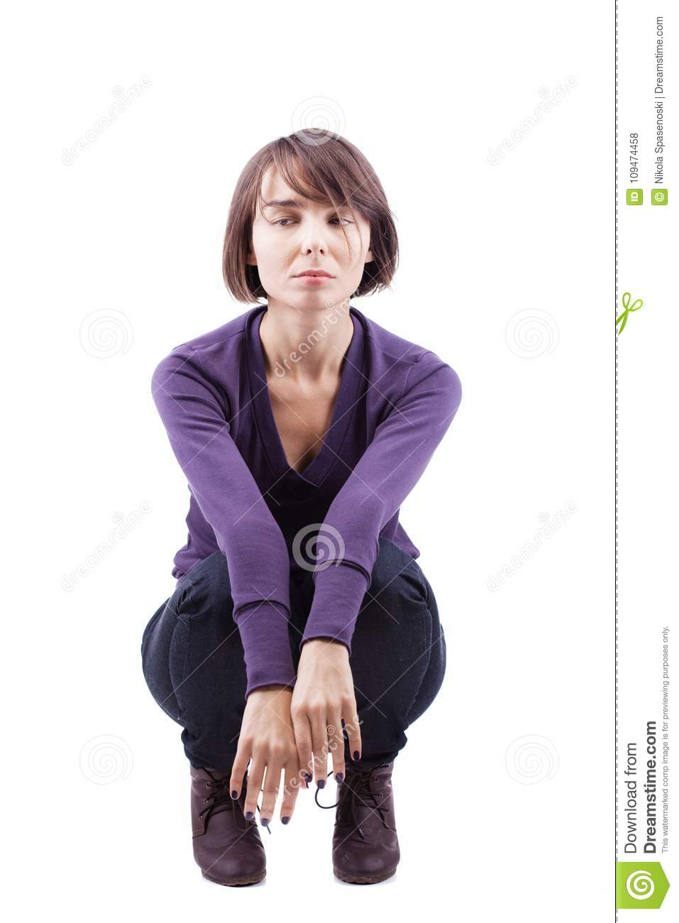 Young Girl Crouching On Floor Stock Photo - Download Image