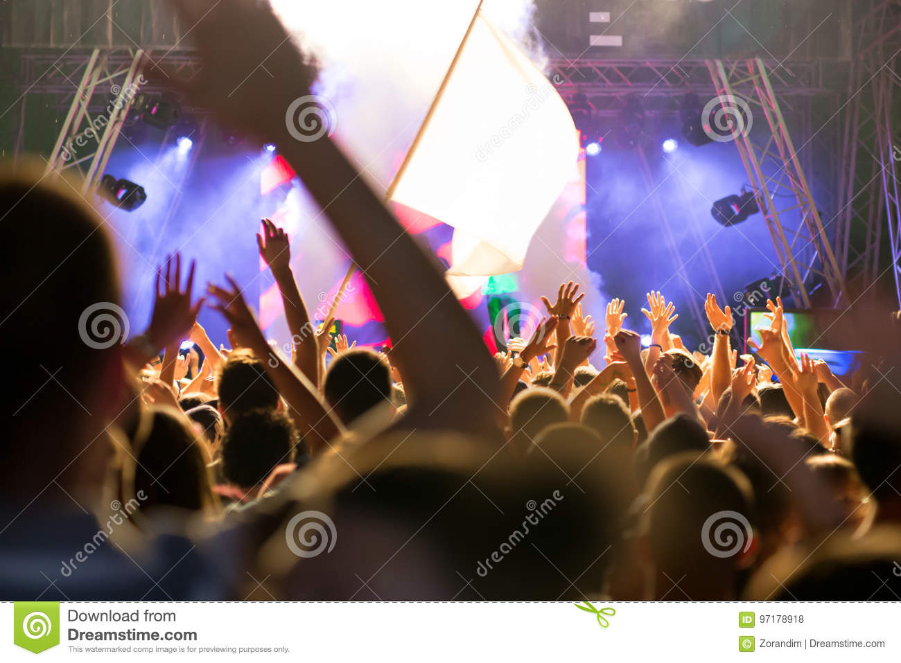 Crowd at concert and blurred stage lights