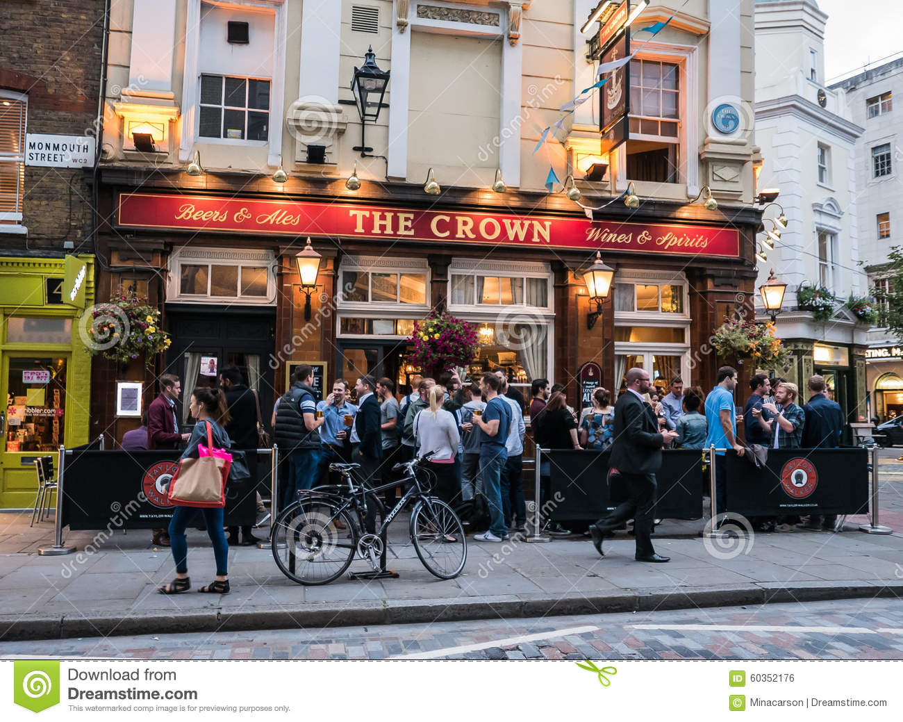 Crowd of drinkers outside the crown pub in london for Stand pub