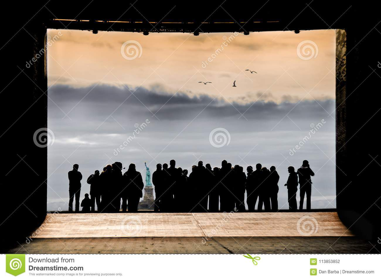 CROWD IN SILHOUETTE TOGETHER LOOKING AT STATUE OF LIBERTY NEW YORK