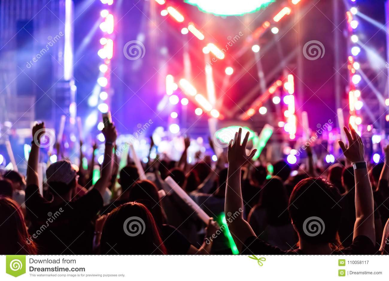 Crowd of hands up concert stage lights