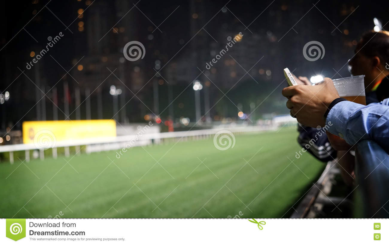 Crowd at horse race course edge cheering, taking photo and prepare for game gabling