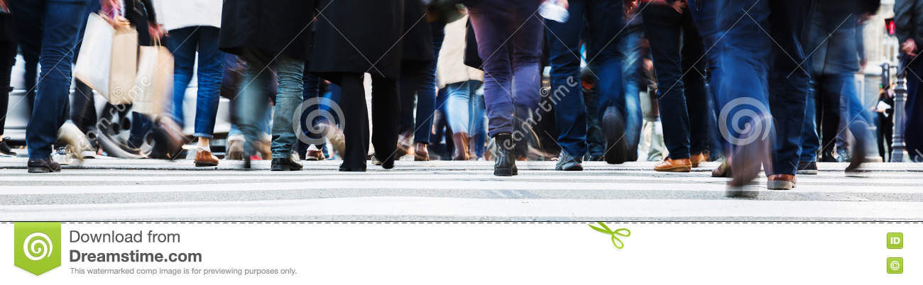 Crowd of people crossing a city street