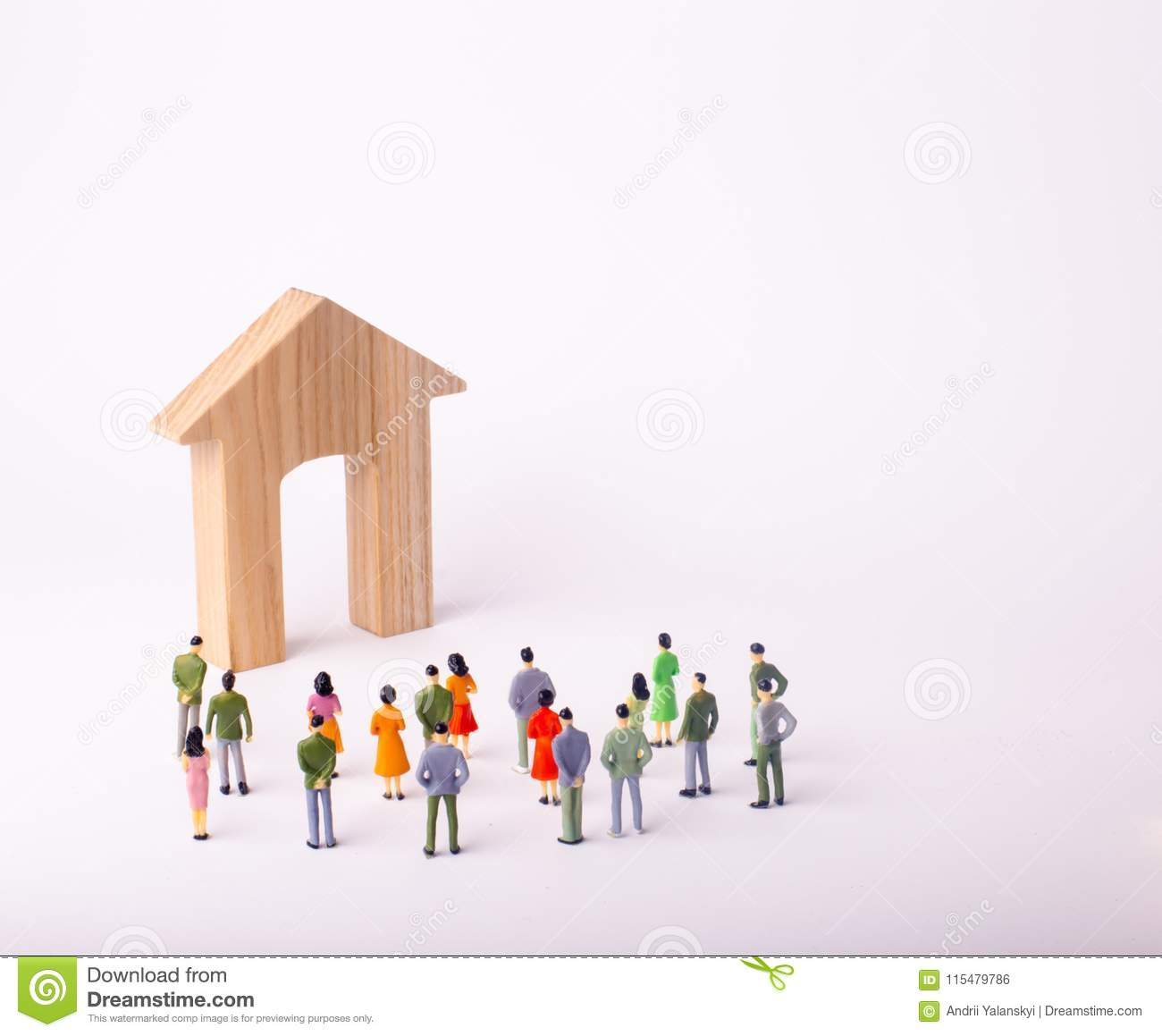 A Crowd Of People Standing And Looking At A Wooden House