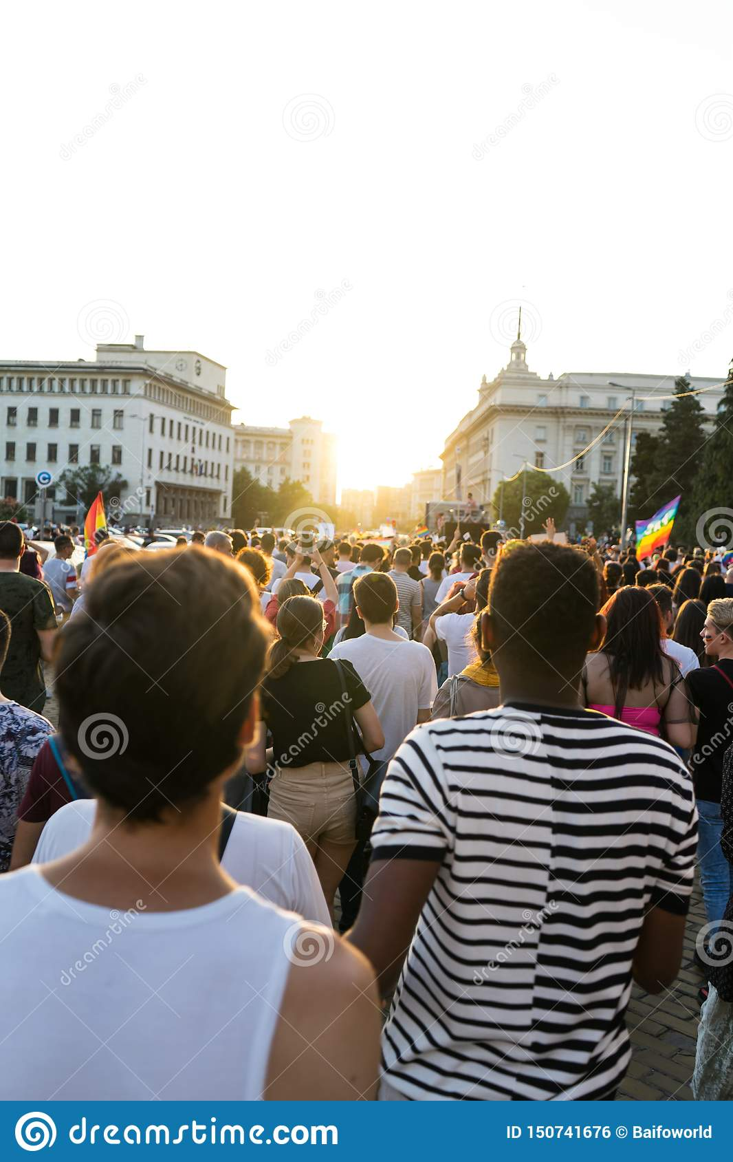 Crowd Waving Rainbow Flags At Pride Parade. People Attending a Gay pride. March with gays and lesbians in the street of Sofia,