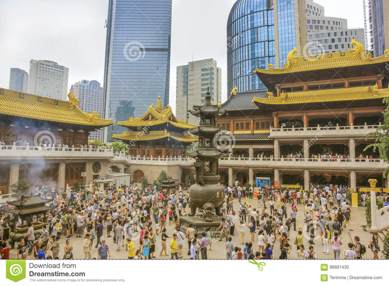 A crowd of worshipers in Buddhist temple Jing`an in Shanghai