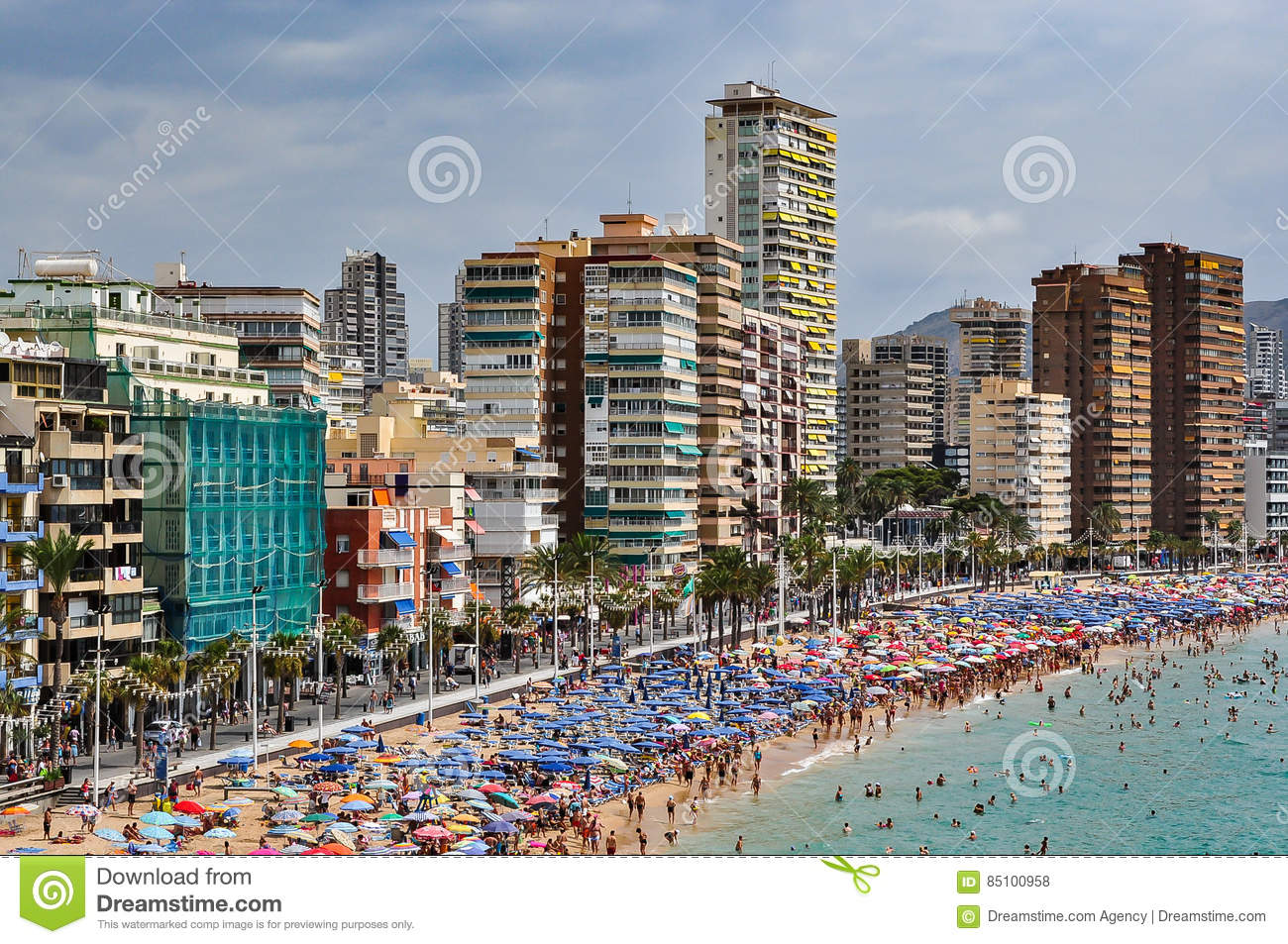 Crowded beach of Benidorm on a cloudy day