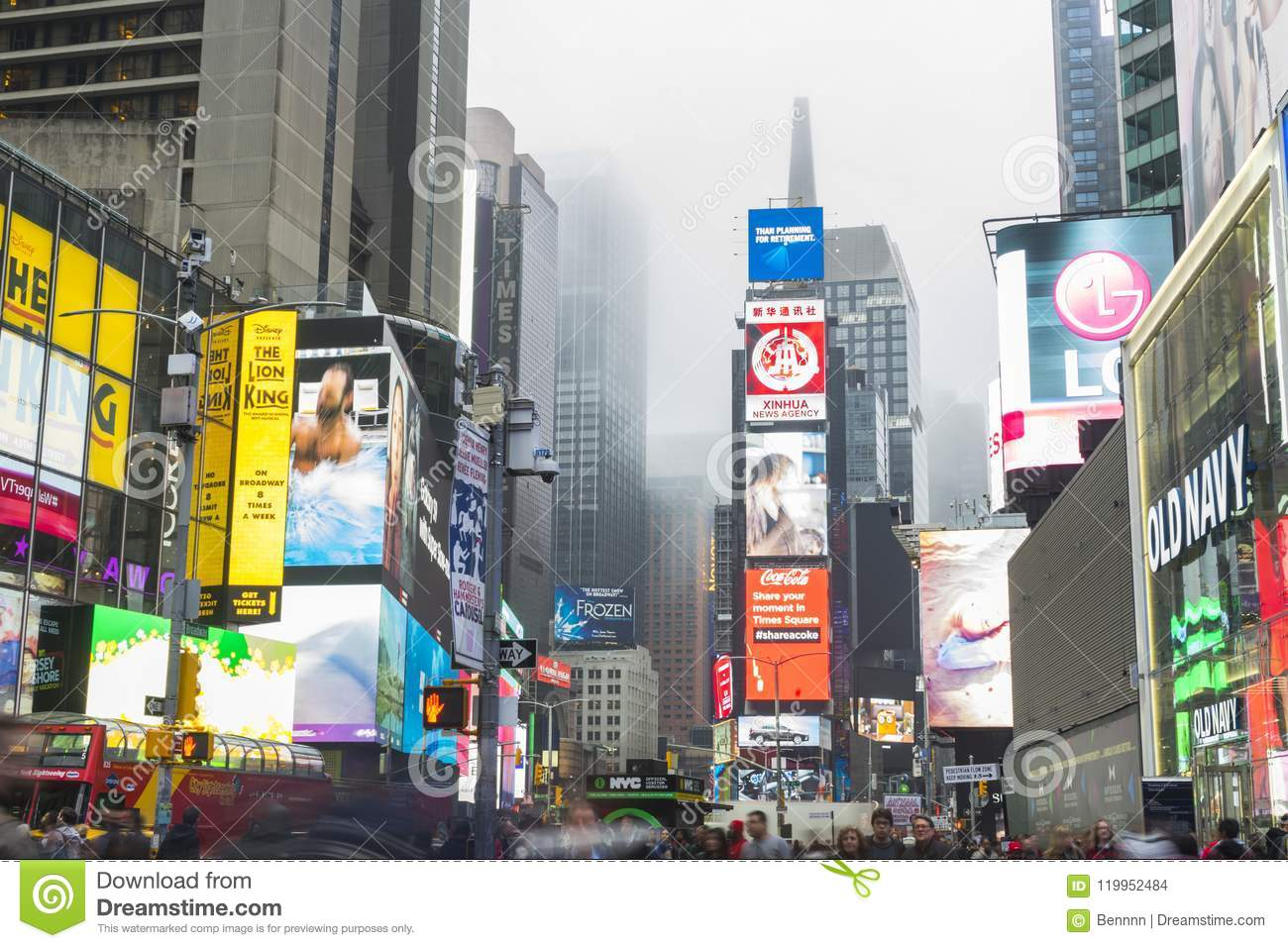 Crowded of tourist walking in Times Square with LED signs