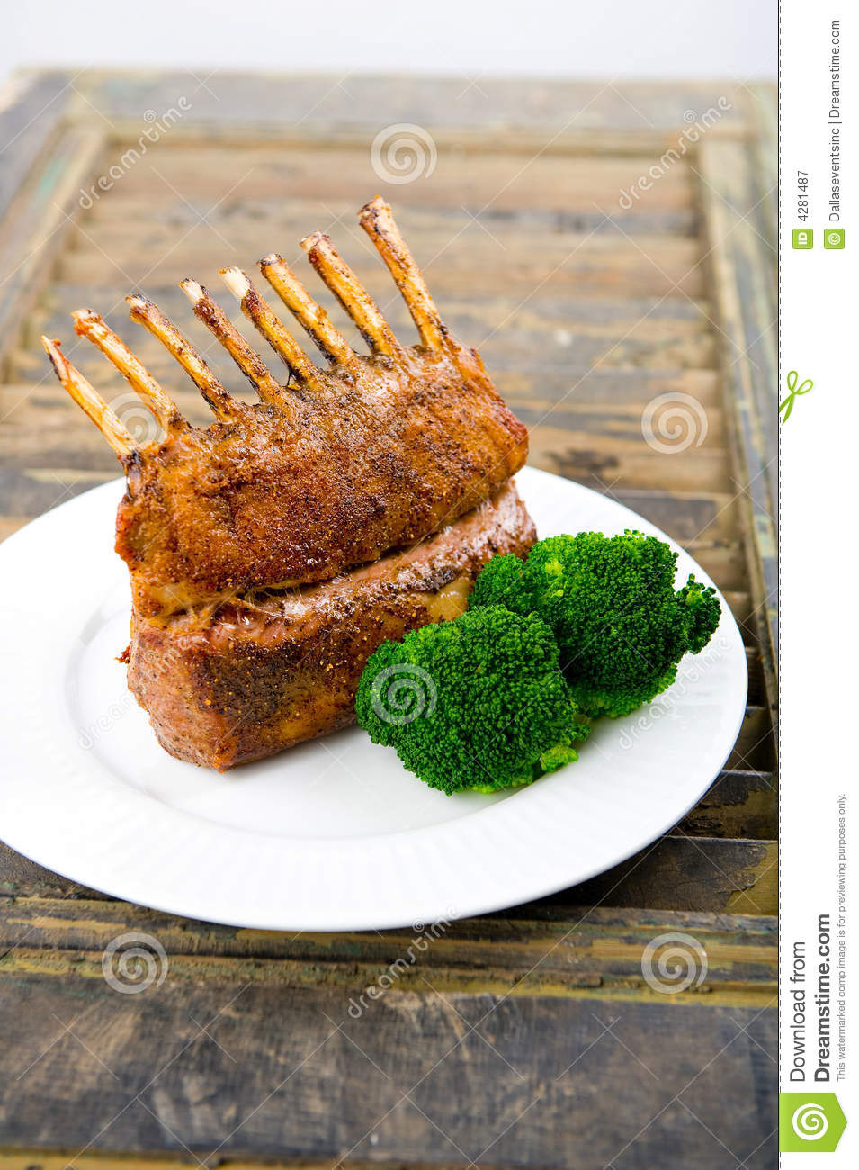 Roasted Rack of Lamb herb crusted on a white plate.