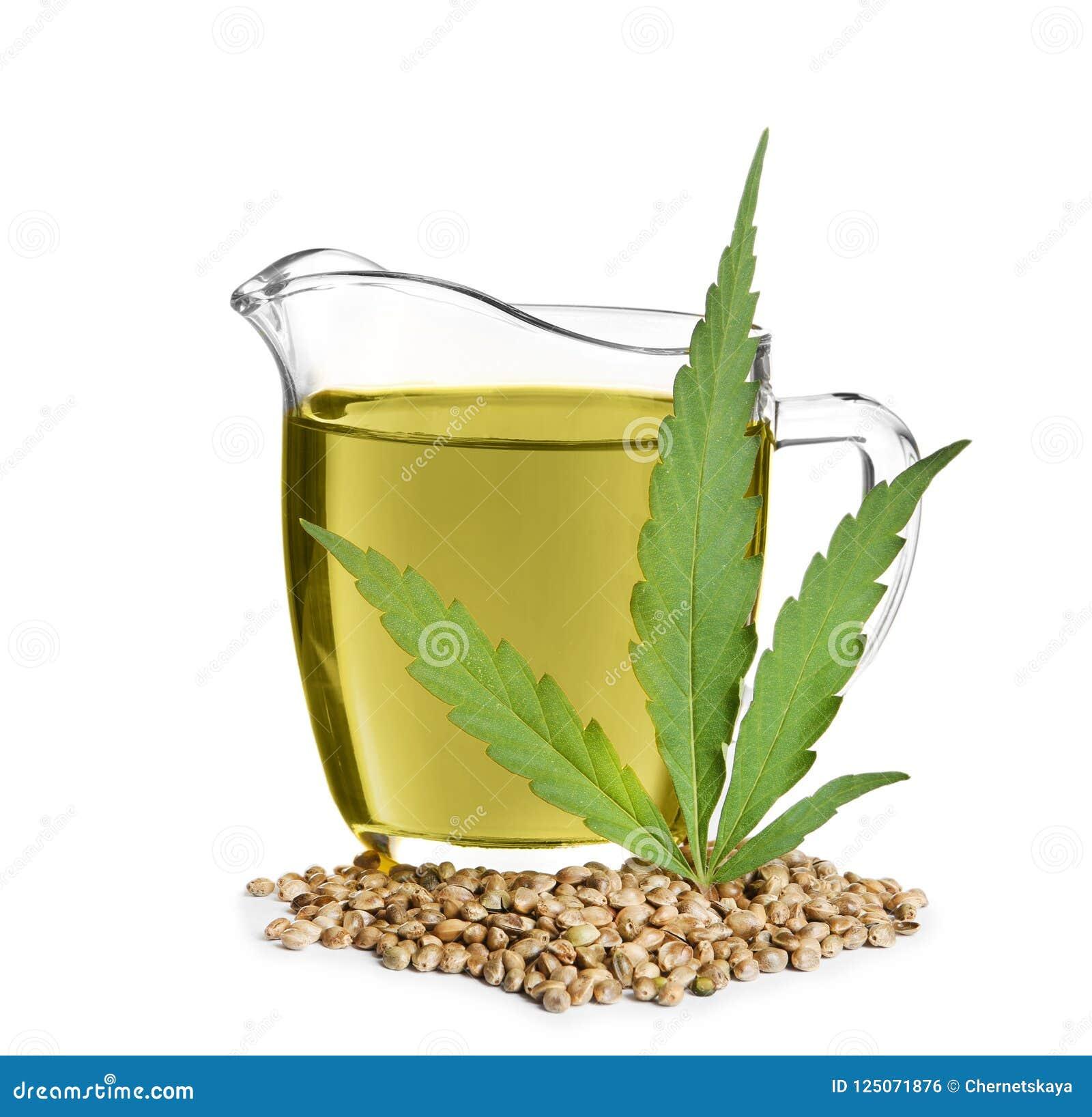 Cruche avec le pétrole, la feuille et les graines de chanvre