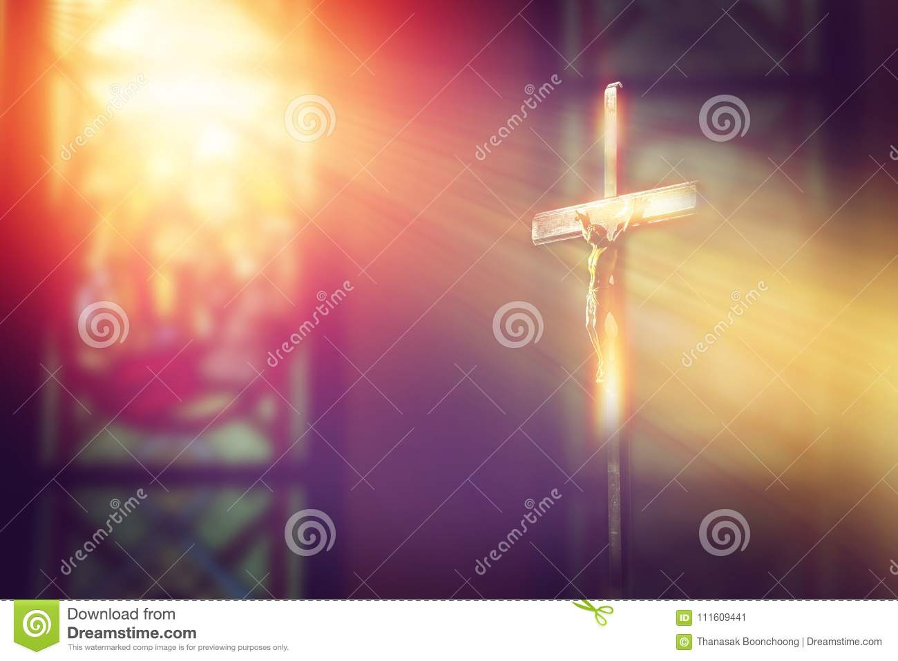 Crucifix, jesus on the cross in church with ray of light.