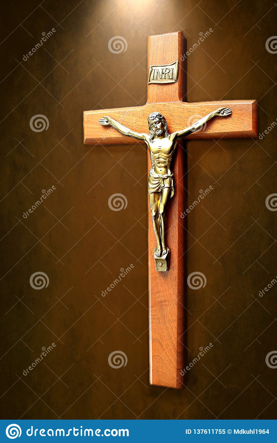 Crucifix with light shining on it isolated on brown mottled background