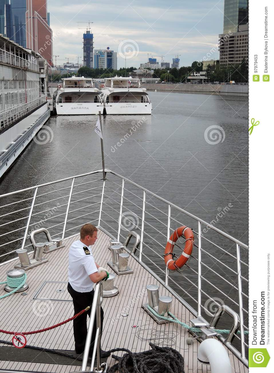 Cruise ship captain stands on a deck