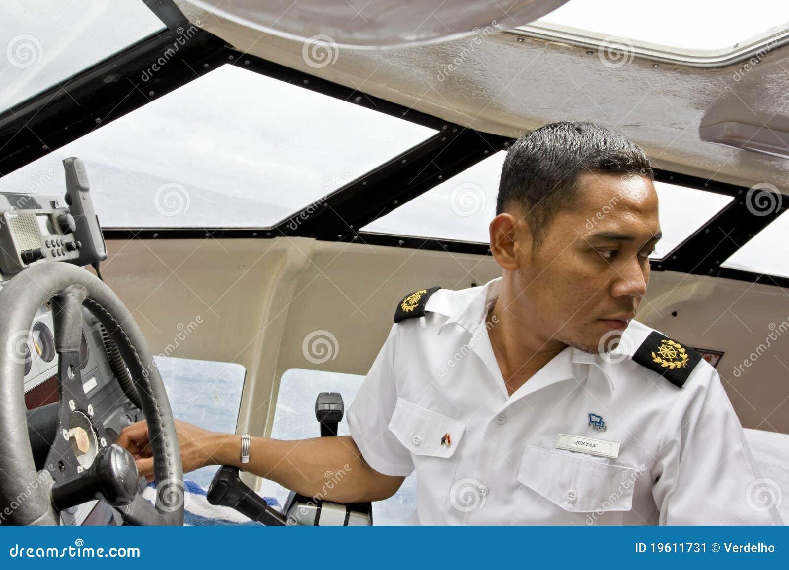 Cruise ship tender pilot manoeuvring boat.