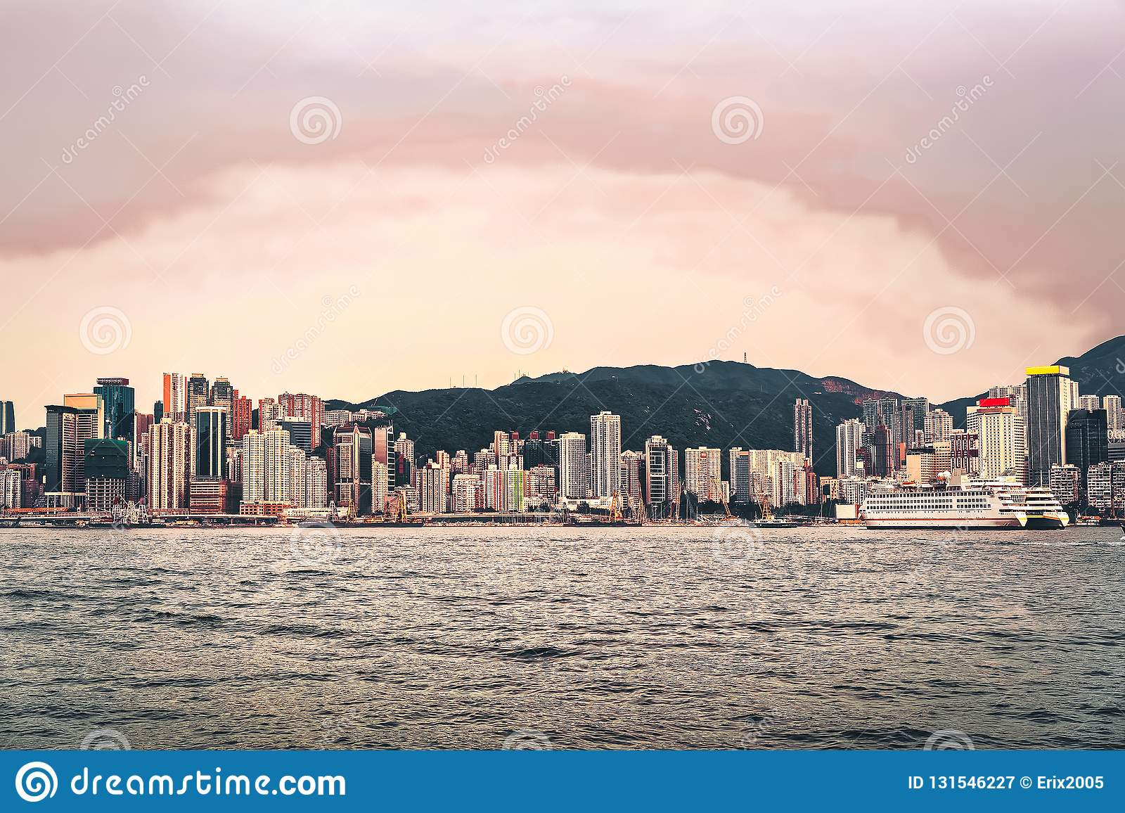Cruise ship and Victoria Harbor in Hong Kong. View from Kowloon on HK Island royalty free stock photography