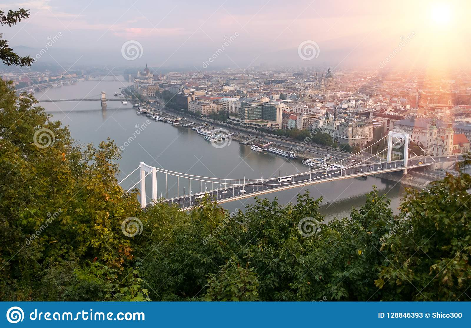 Cruise Ships And Ferries In The Evening At The Danube River