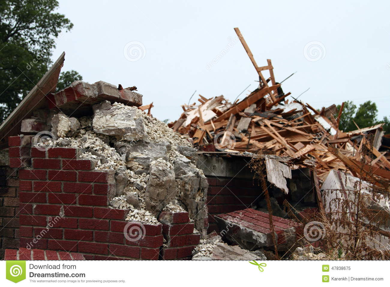 Building Falling Down : Crumbling concrete and falling down bricks with piles of