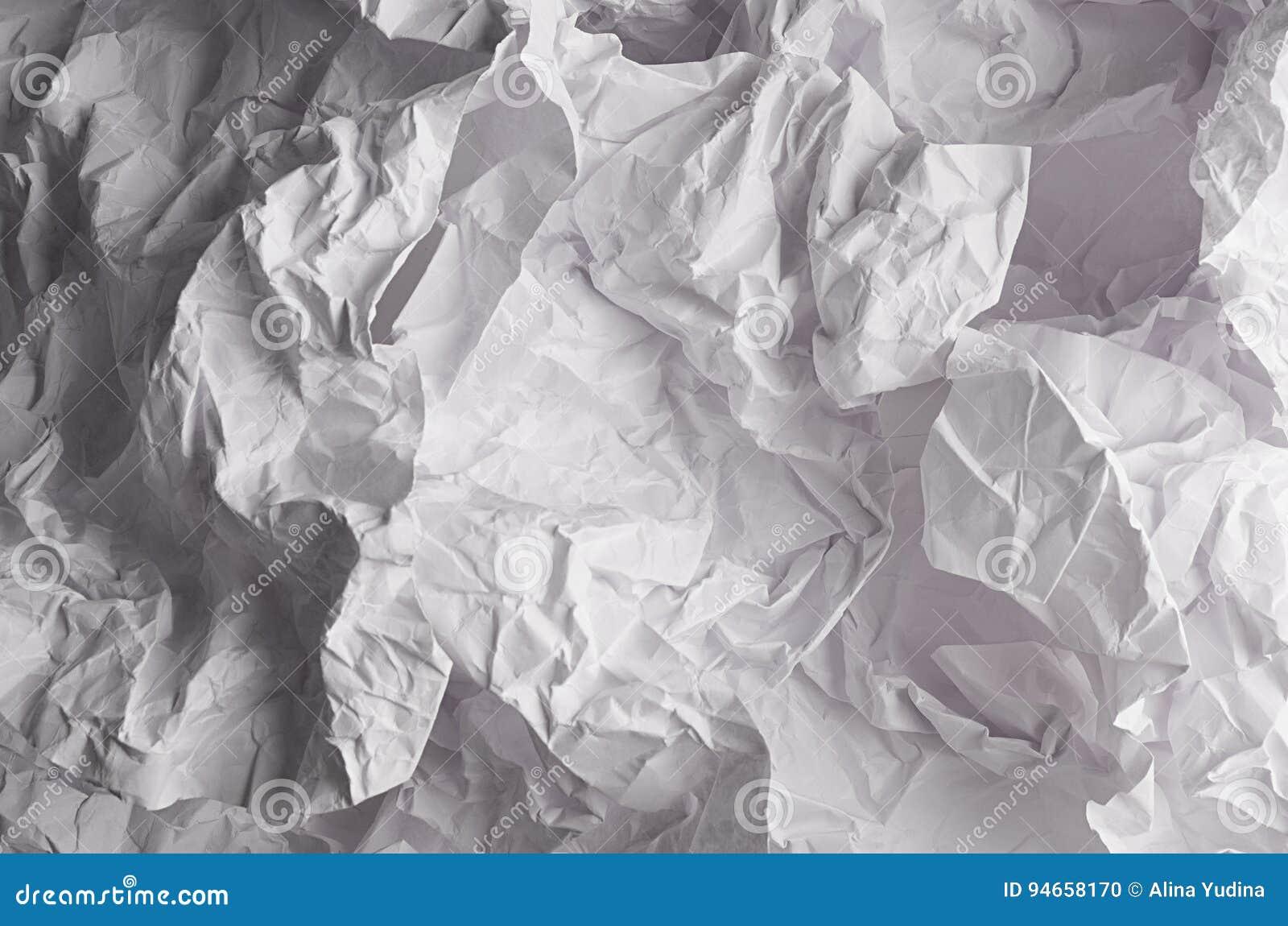 Crumpled сморщило волнистую серую бумажную текстуру, абстрактную предпосылку полигона
