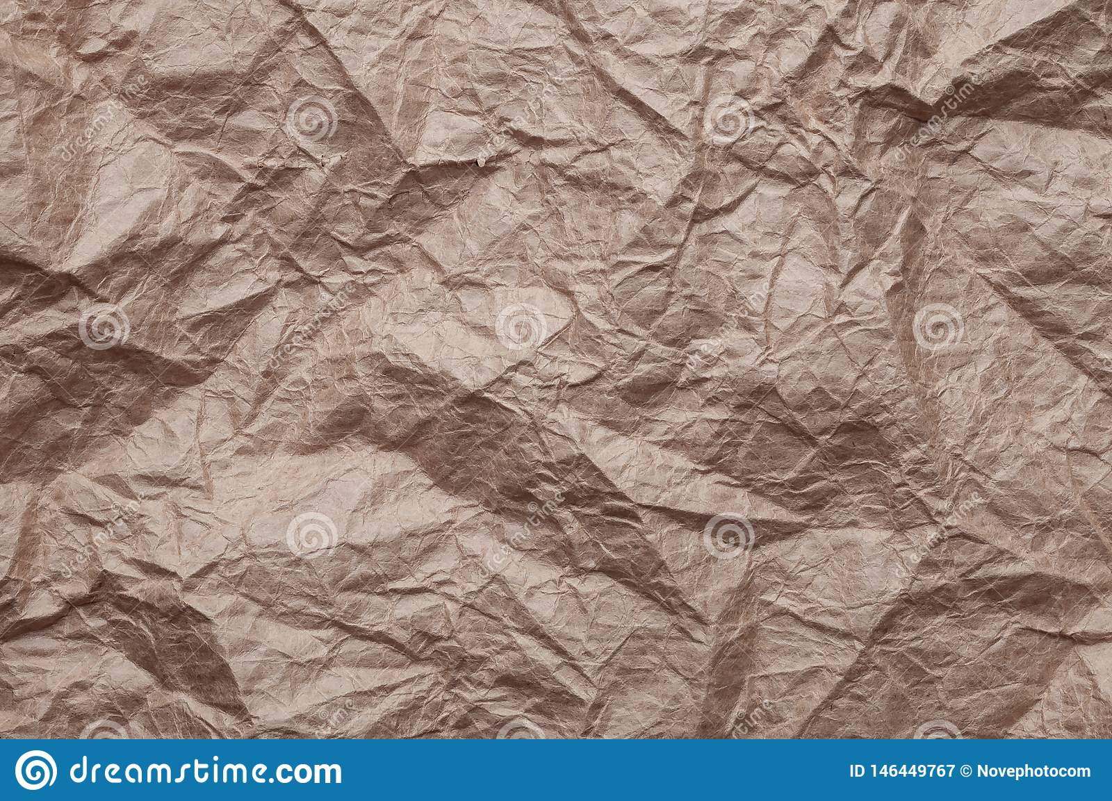 Crumpled kraft paper. Texture crumpled recycled old brown paper