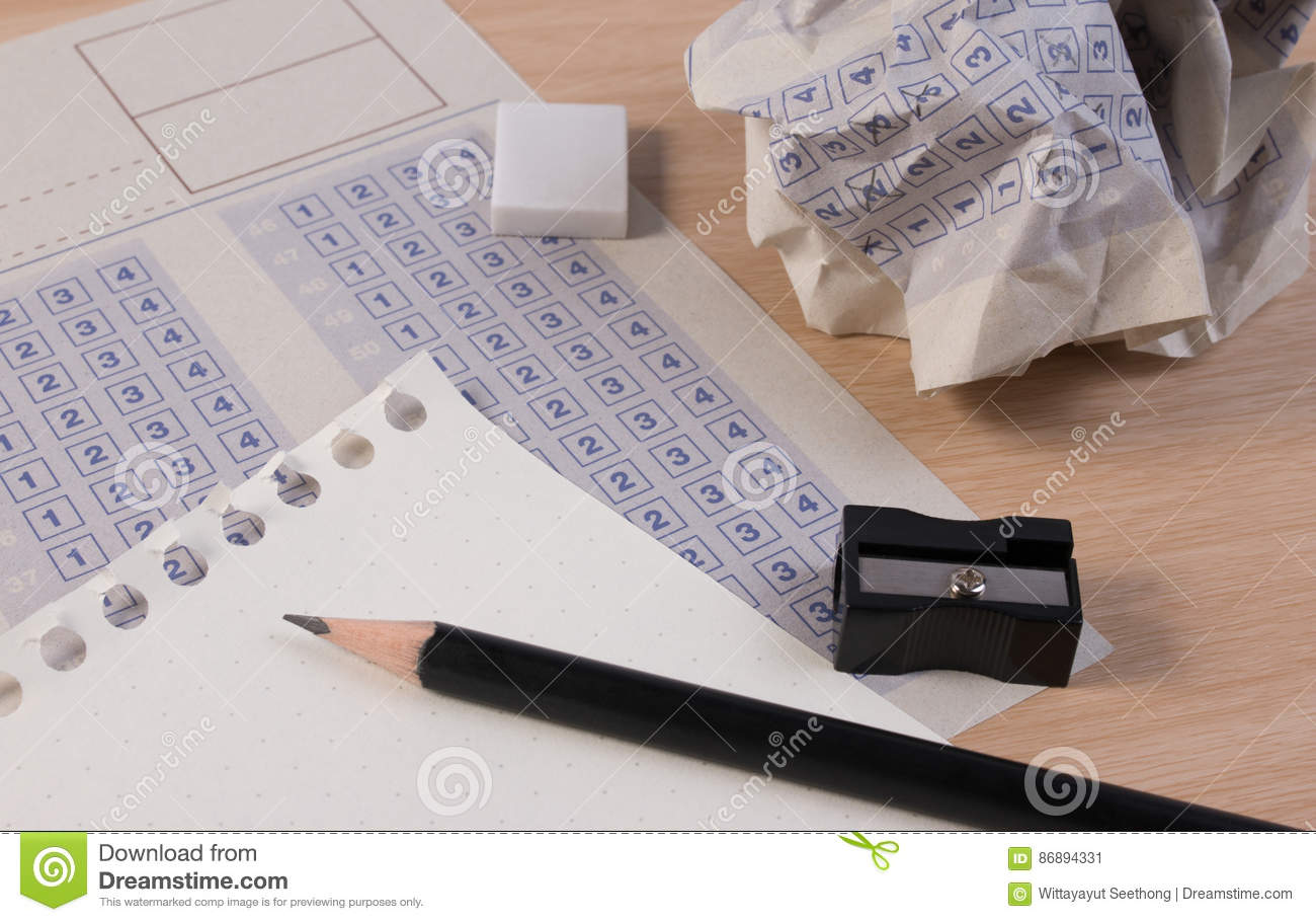 Crumpled Paper Ball Of Vintage Classic Answer Sheet With Pencil Sharpener And Reduction Cross The Right In Box Blank