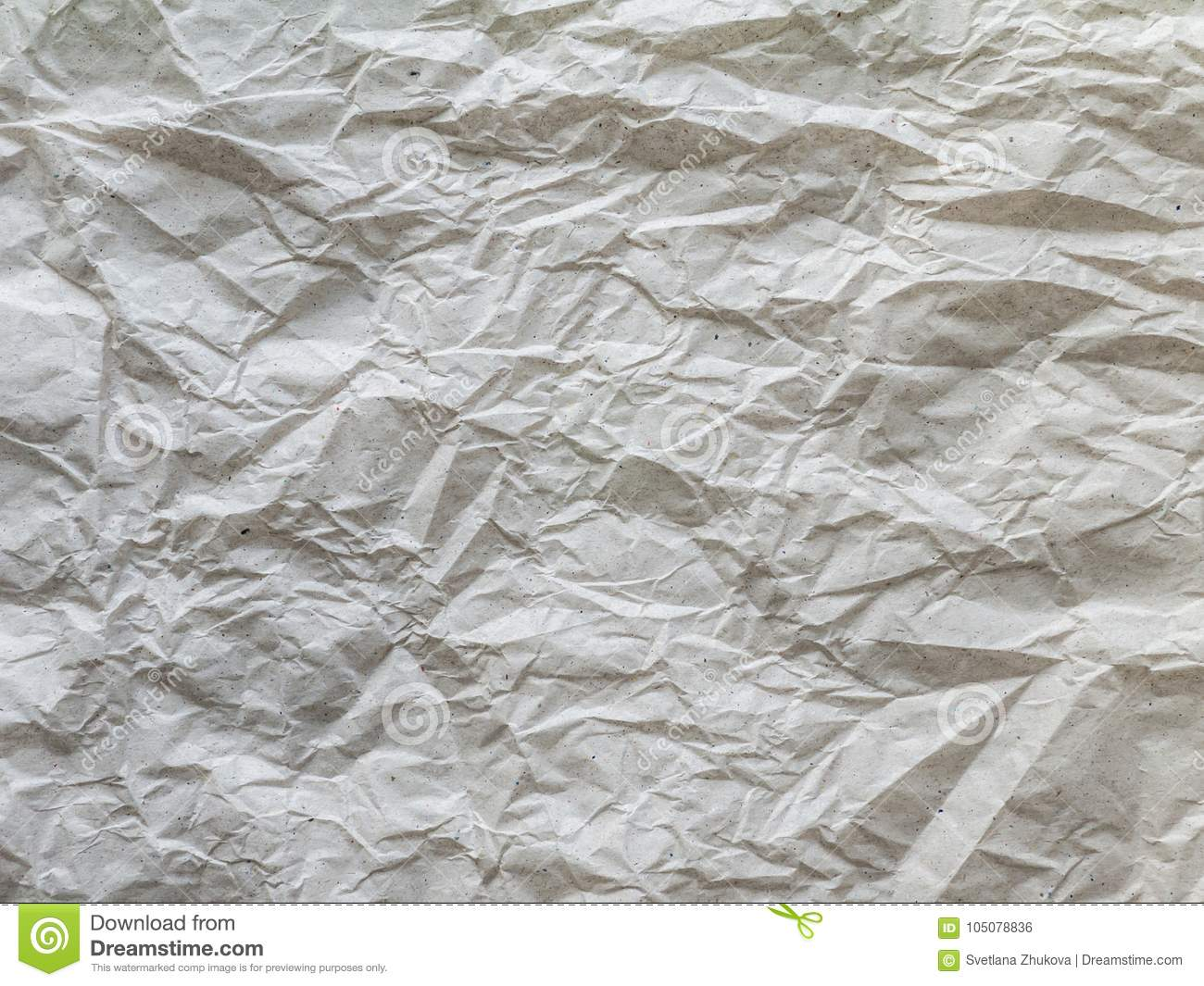 Crumpled recycled gray packing paper