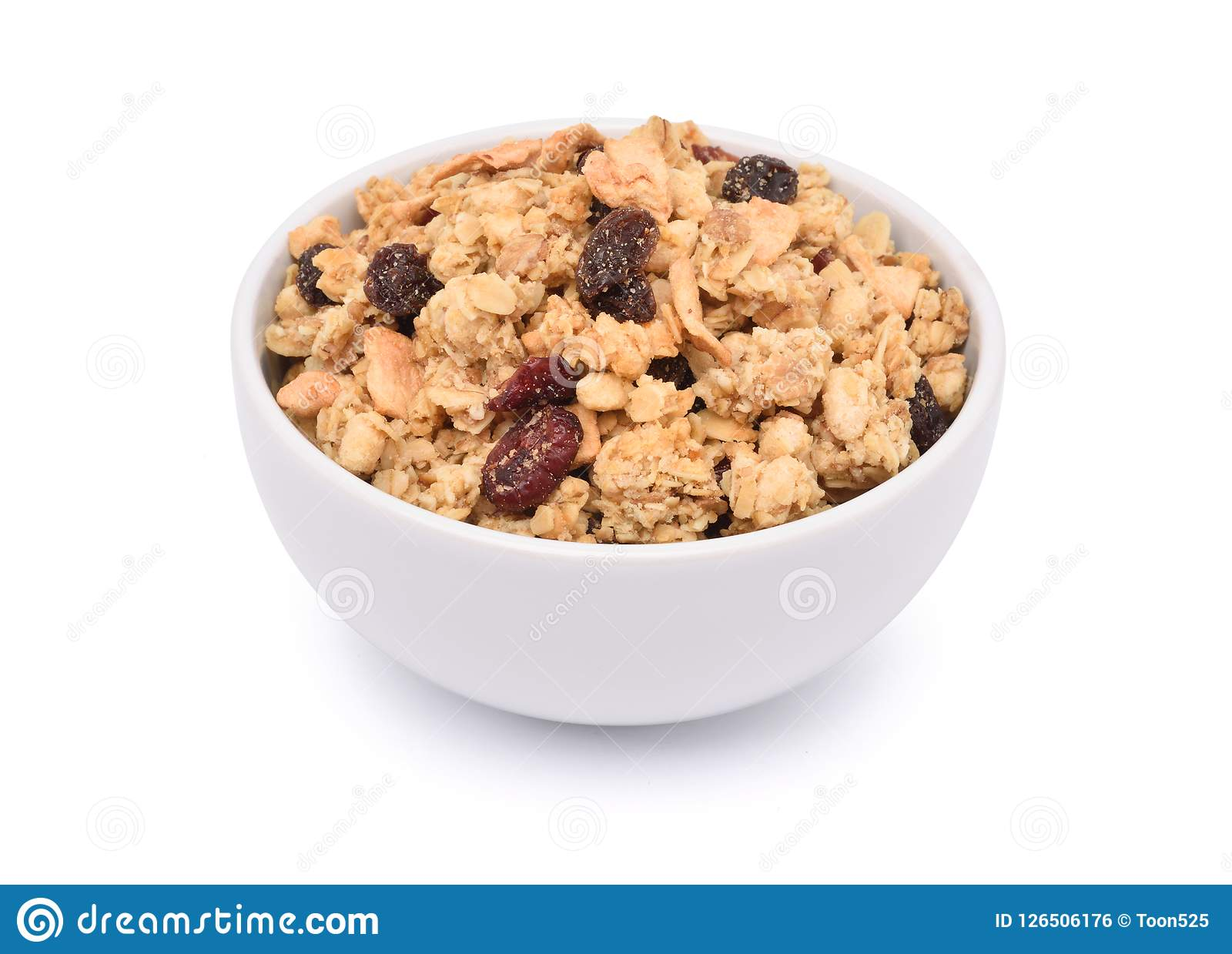 Crunchy oat granola cereal with dried fruits in white bowl
