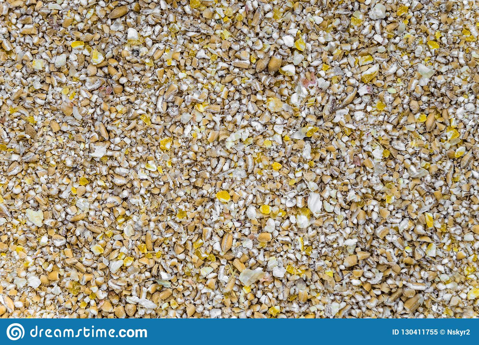 Crushed grains of dried corn and wheat