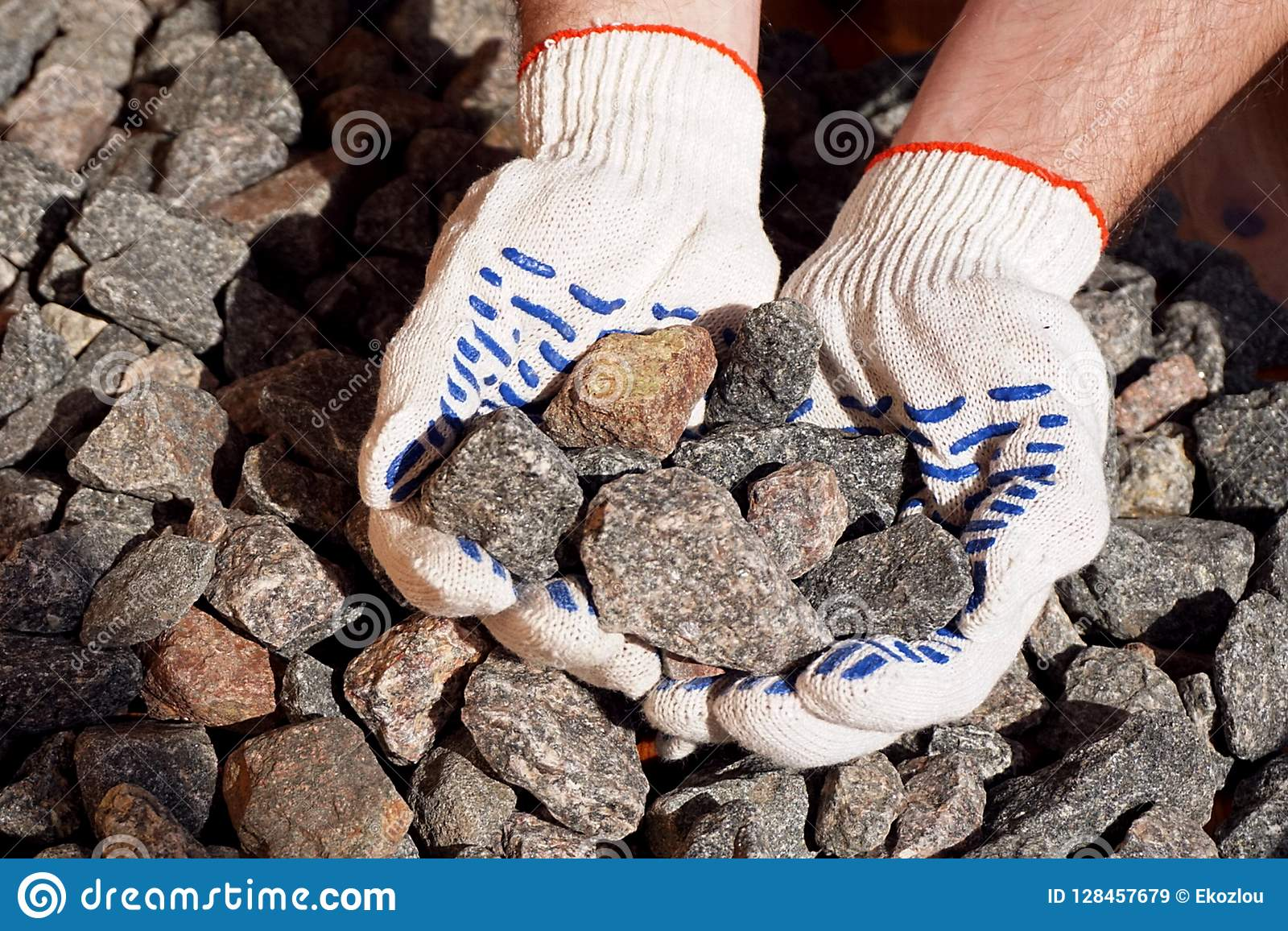 Crushed stone in hands