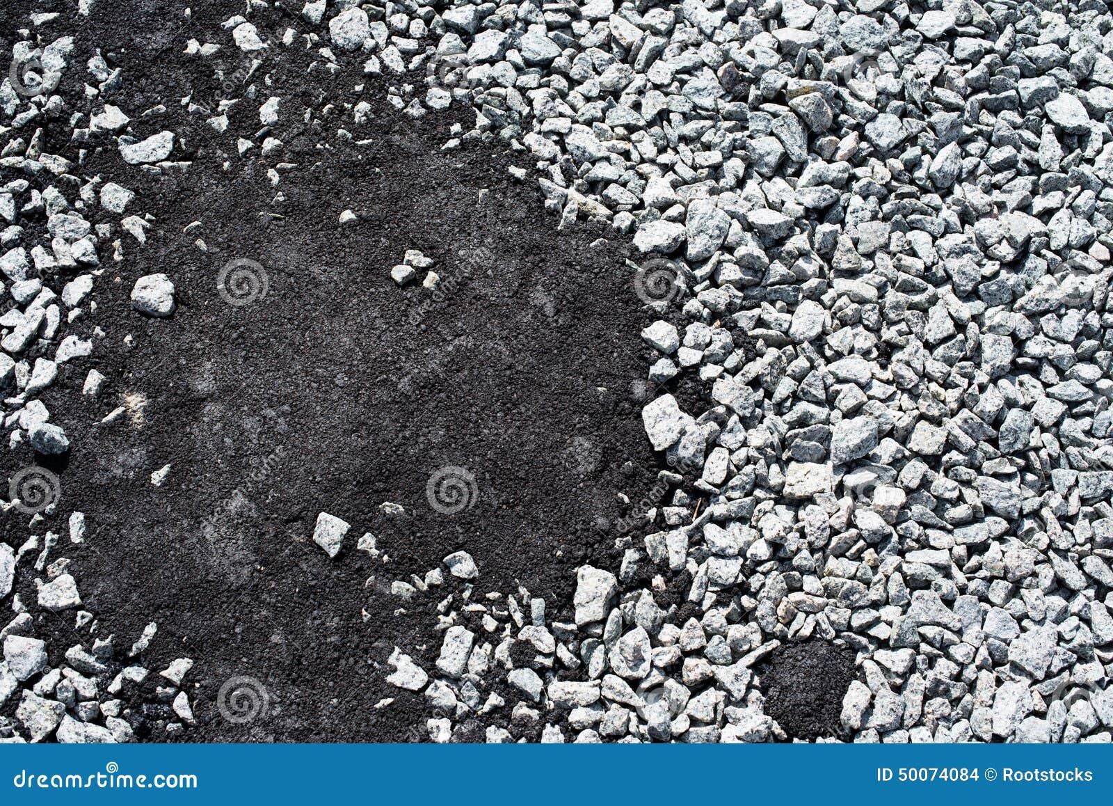 Download Crushed Stones Partly Covered With New Asphalt Concrete Stock Photo - Image of asphalt, broken: 50074084