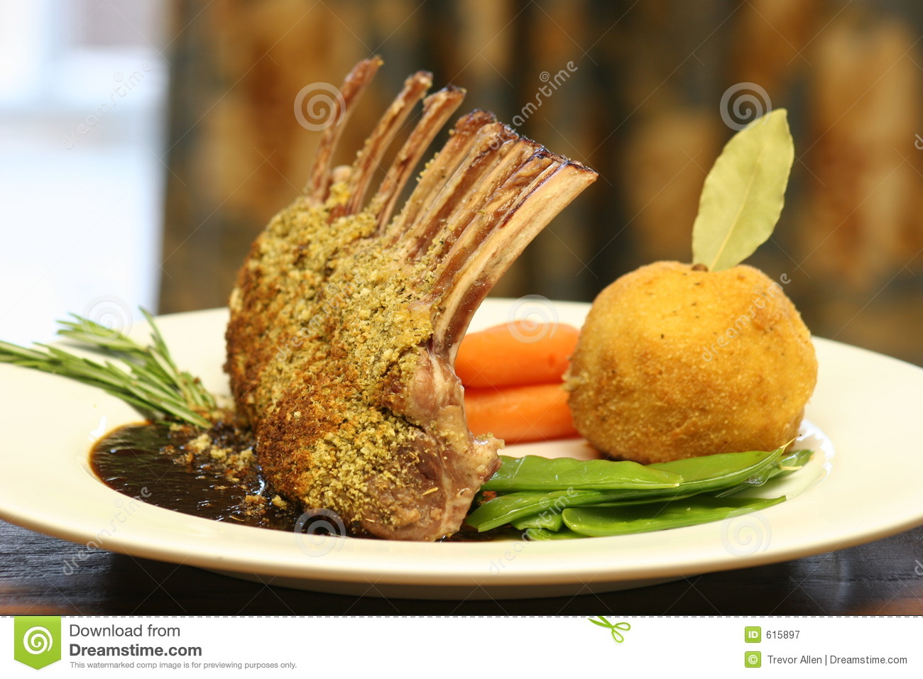 Rack of Lamb crusted with mustard and crumbs.