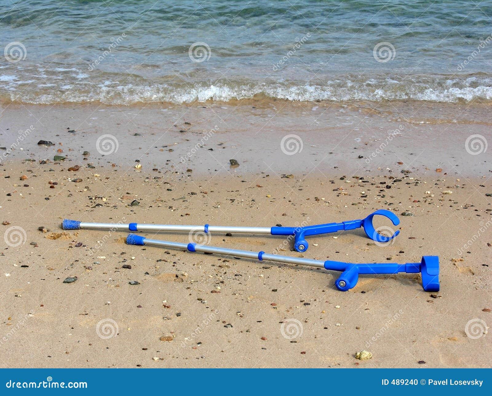 Crutches on beach