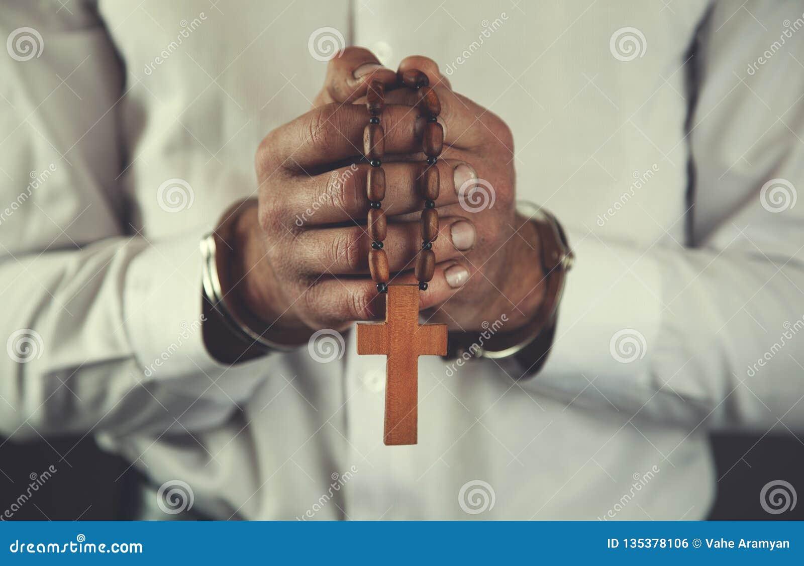 Cruz da mão do homem