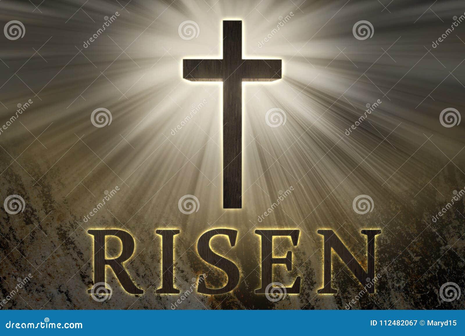 Cruz de Jesus Christ cercada pela luz e pelo texto aumentado em um fundo da rocha para a Páscoa