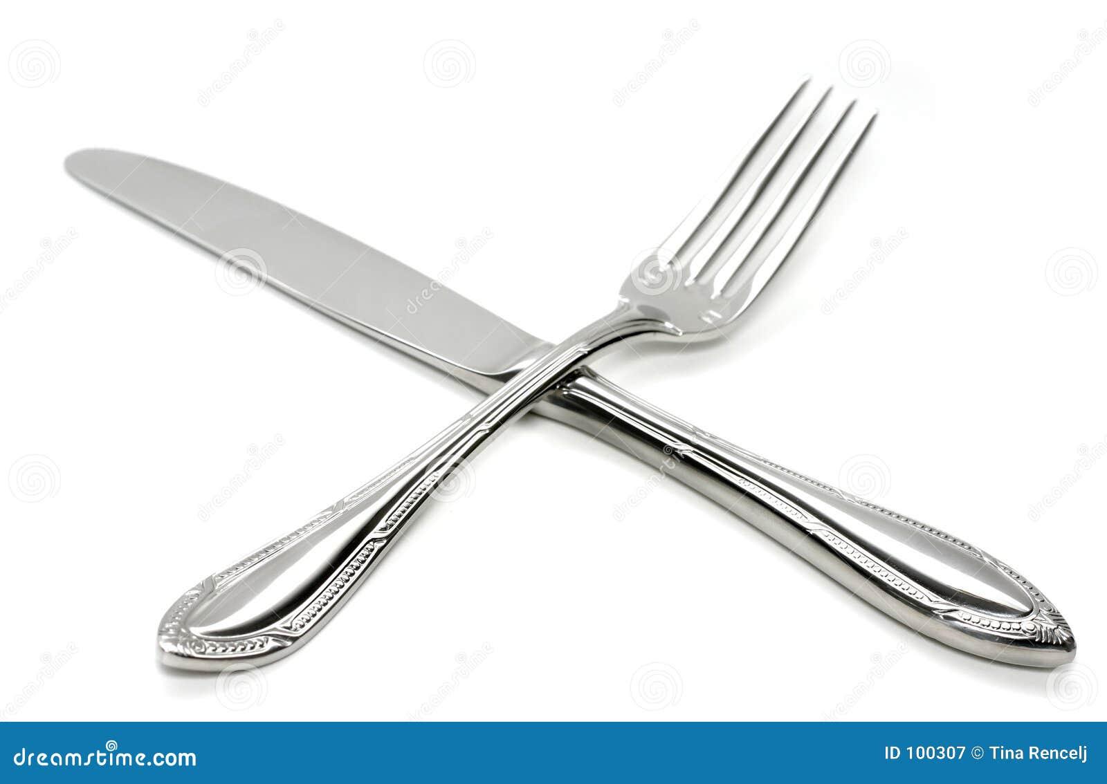 Cruz de prata da forquilha e da faca