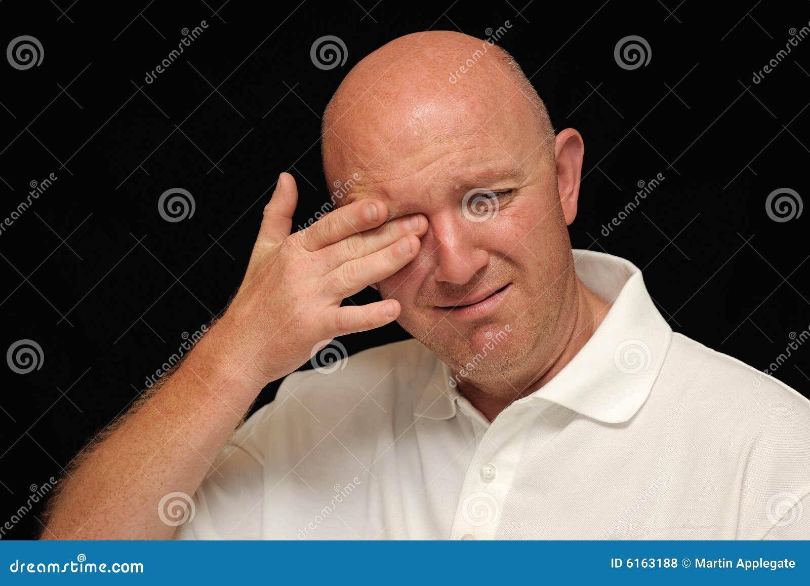 Bald man crying