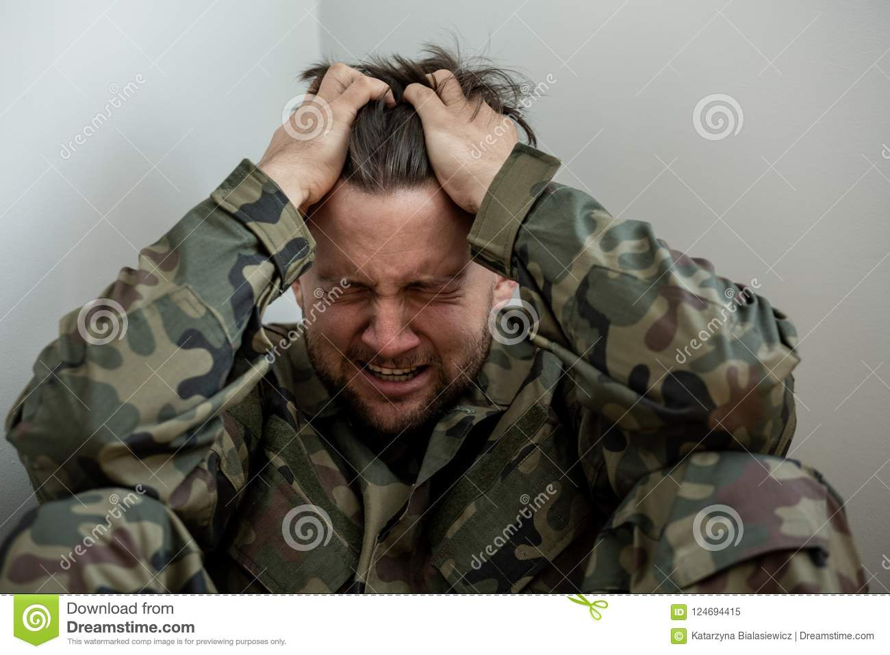 Crying professional soldier with depression and trauma after war