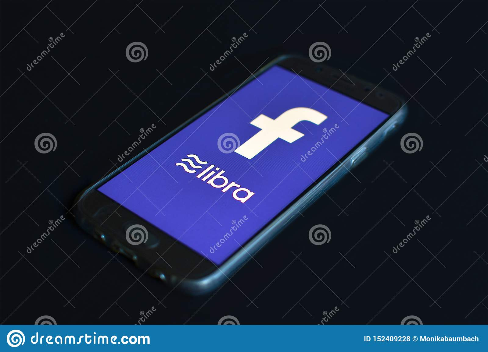 Cryptocurrency Libra concept mobile phone with Libra and Facebook logo