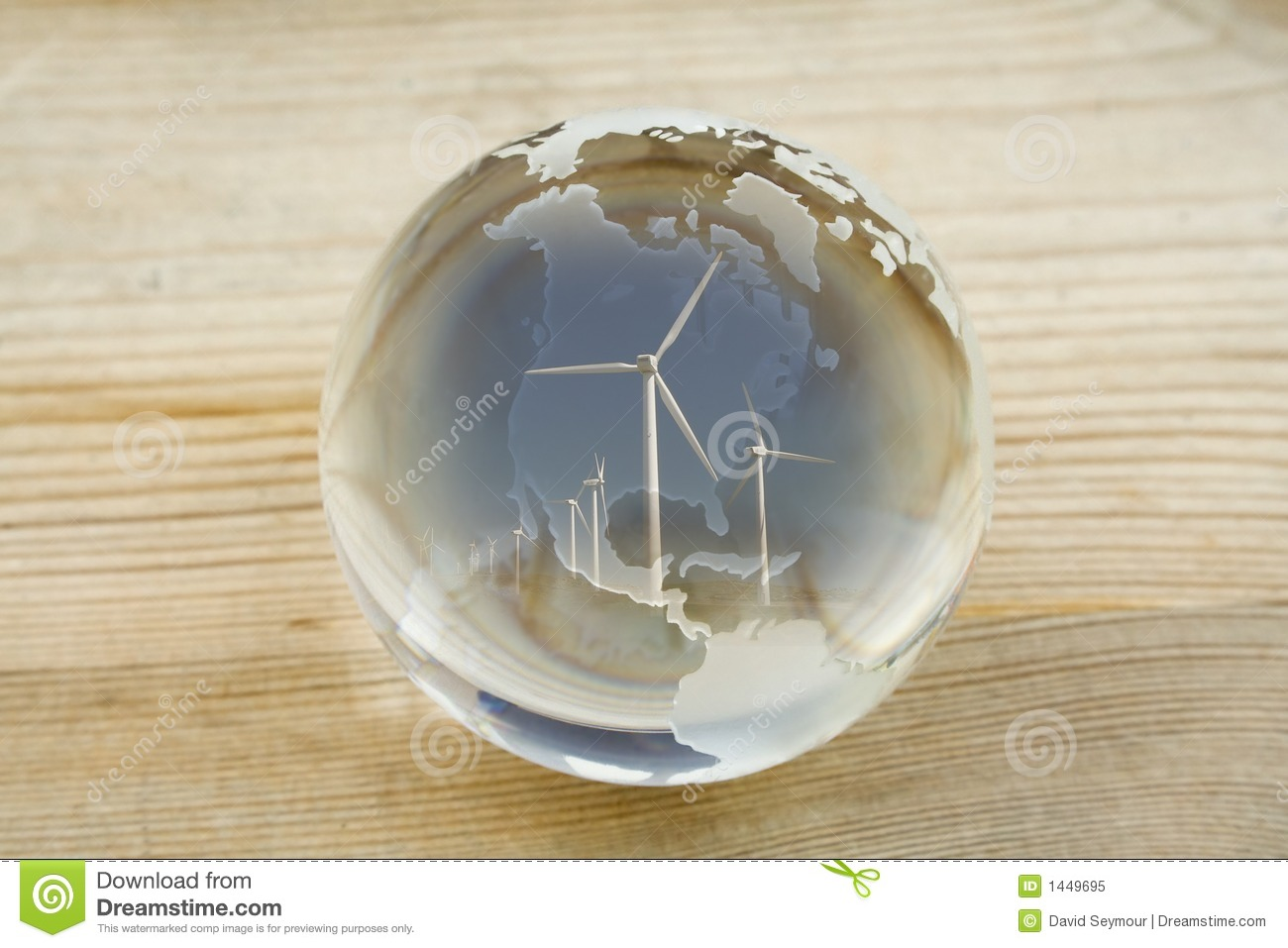 Crystal ball globe with wind farm over North and Central America